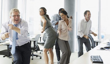 happy employees dancing in the office